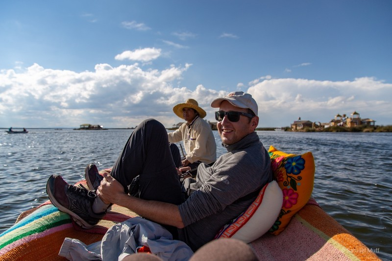 Sam with our host on a boat made from totora reed
