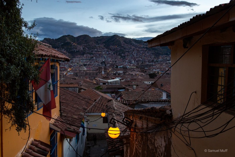 Cusco in the evening from a narrow alley
