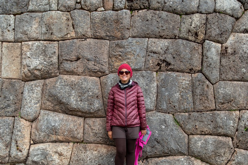 Marta in front of an Inca stone wall in Puka Pukara