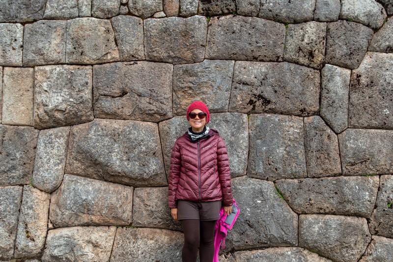 Marta in front of an Inca stone wall in Puka Pukara
