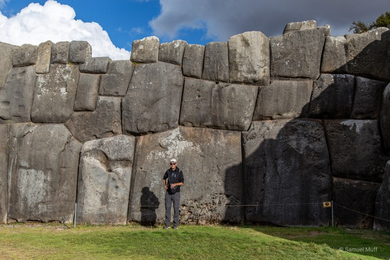 Sam in front of an Inca stone wall in Saqsaywaman
