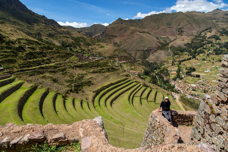 Sam in front of the terraces at the Inca site in Pisac