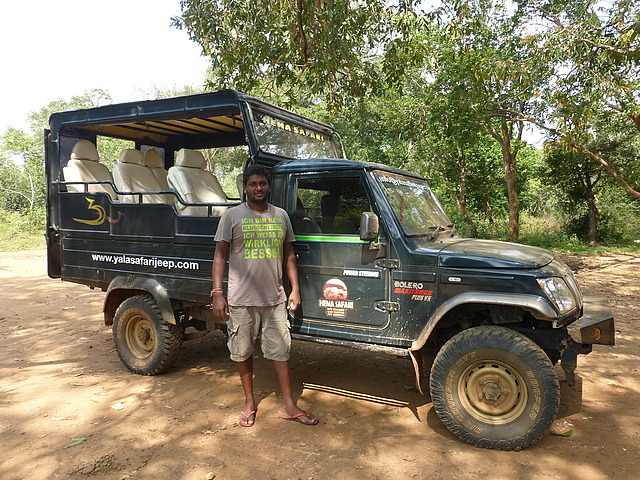 Driver (Sanjaya) and jeep at breakfast stop