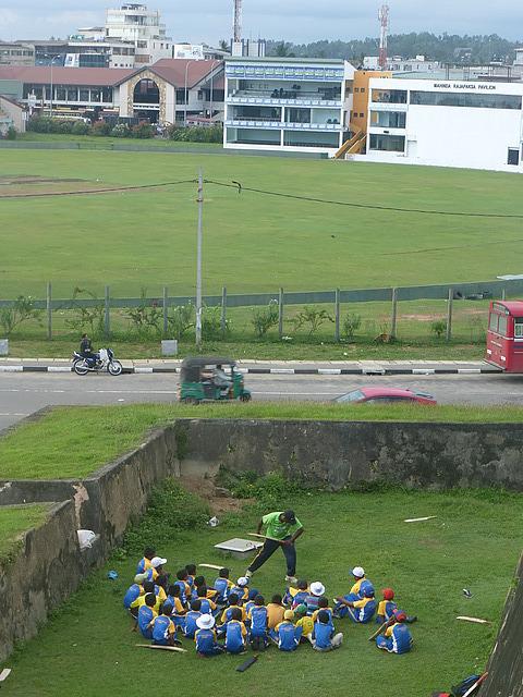 Cricket lesson! - cricket ground behind