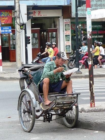 Around HCMC - Cyclo driver having lunch