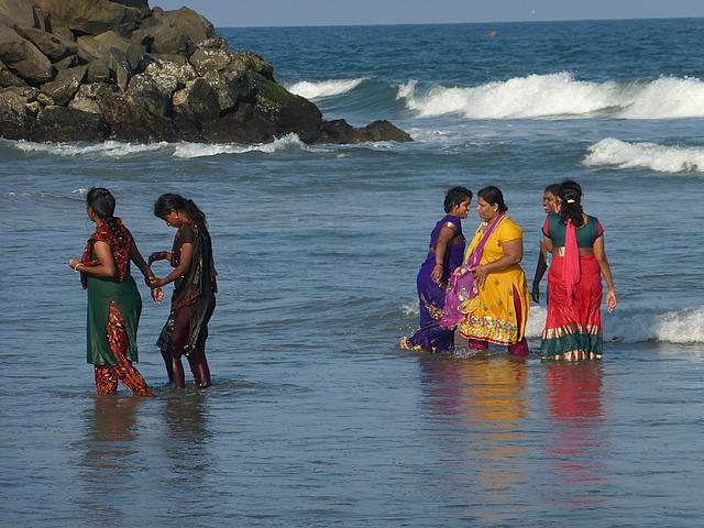 Beach scene by Shore Temples - Ladies in water