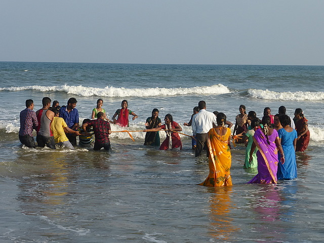 Beach scene by Shore Temples - tug of war
