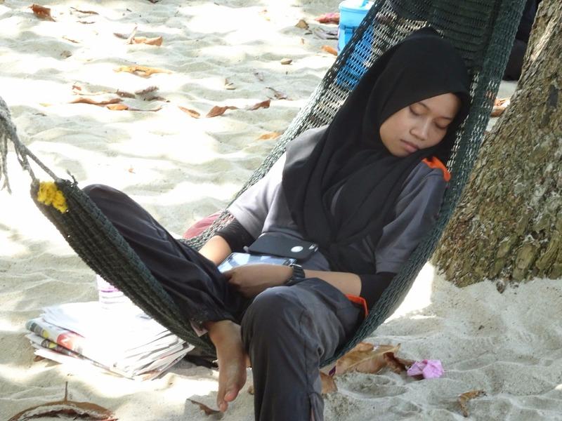 Local enjoying a hammock