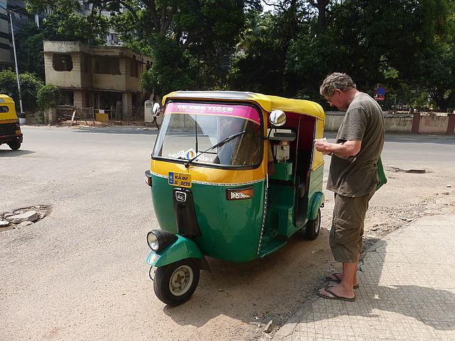 Paying the auto rickshaw man