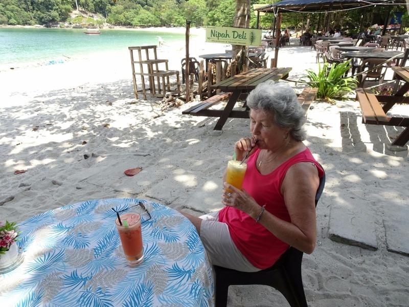 Enjoying fresh pineapple and mixed fruit juices