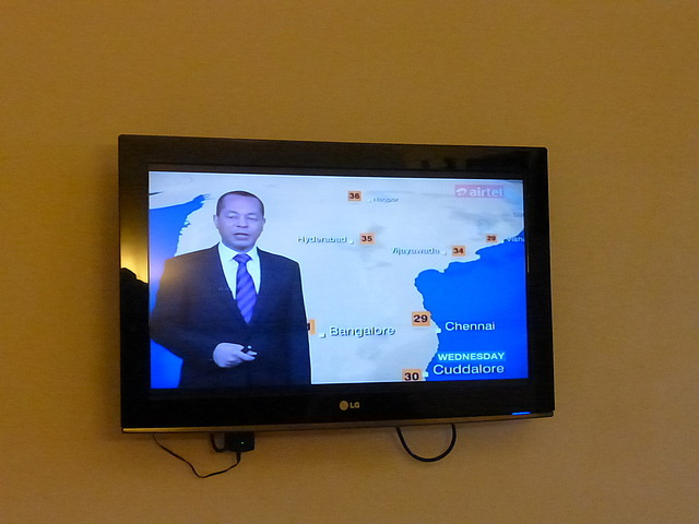 Wide screen TV in hotel room - BBC World weather