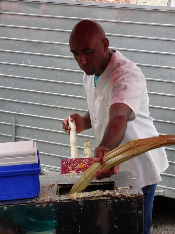 Around Curitiba Sunday Artisan market - preparing cane sugar drink