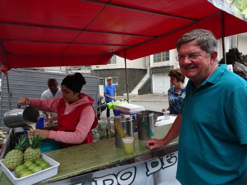 Around Curitiba Sunday Artisan market - pouring cane sugar drink