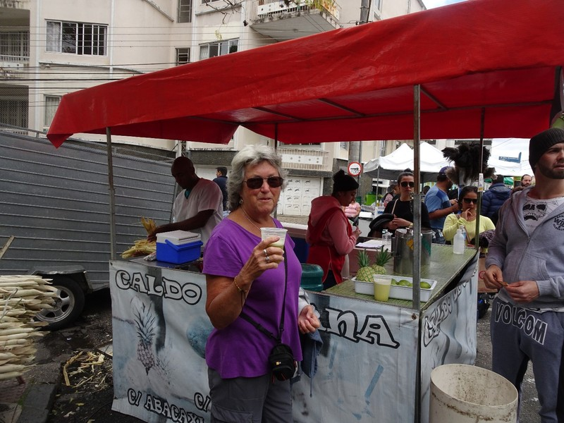Around Curitiba Sunday Artisan market - enjoying cane sugar drinks (hers with lime, his with pineapple
