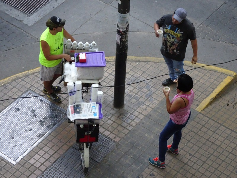 Hostal Confluencia - Morning coffee seller on street outside