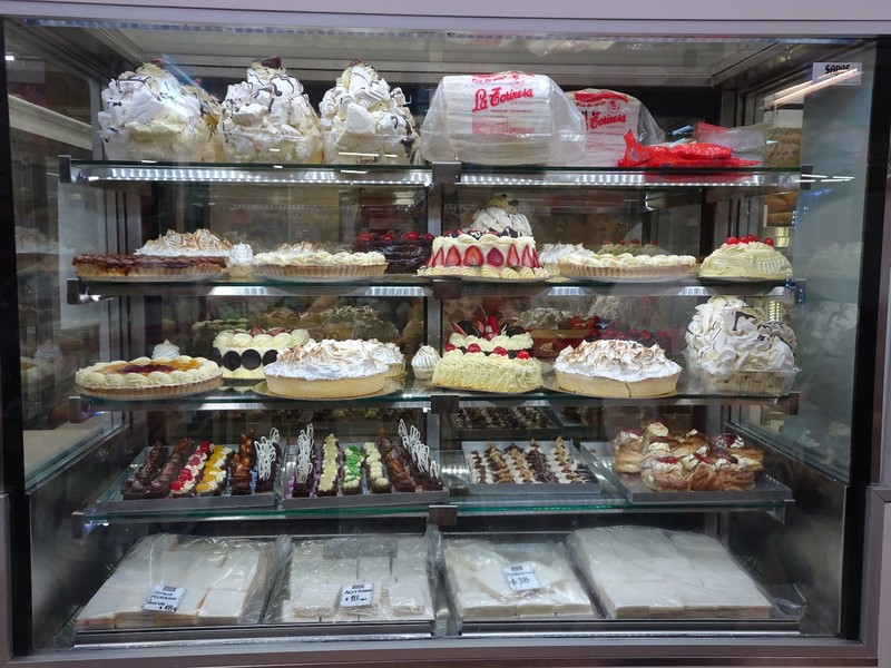 Mercado Central - Cake and sandwich (white) display (Note: the cut, sliced white sandwiches  - popular all over Argentina it seems)