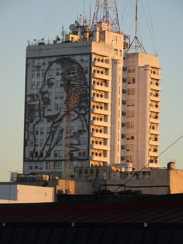 View from our hotel balcony in setting sun - Eva Peron image on building