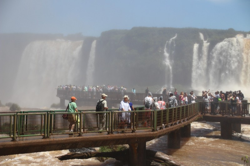 Iguacu falls - Lindsey on main walkway in front of biggest and highest waterfall