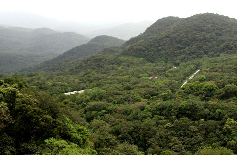 Serra Verde Express - unbelievably long goods train going round the bends down the track