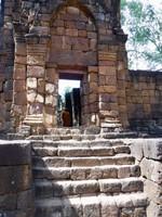 Monk Enters Ancient Khmer Temple