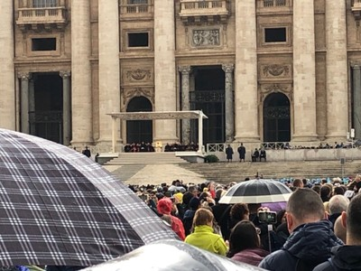 Pope Francis is in the cream robes in the centre of the podium