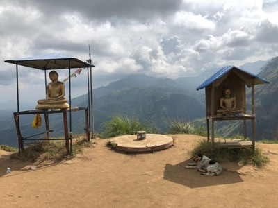 Buddhas and trig station on Little Adam's Peak