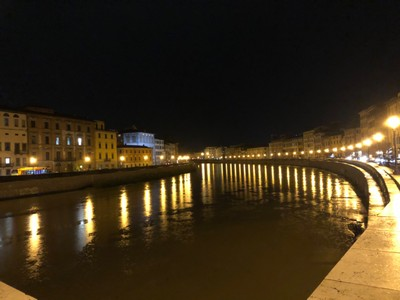 The Arno river in Pisa at night