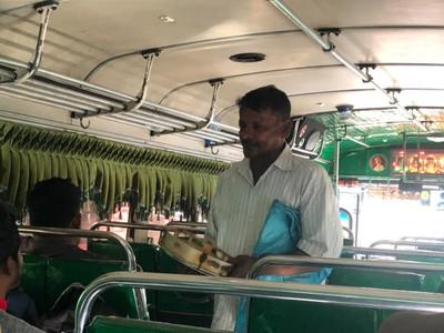 Tambourine-playing beggar on the bus at Thanamalwila