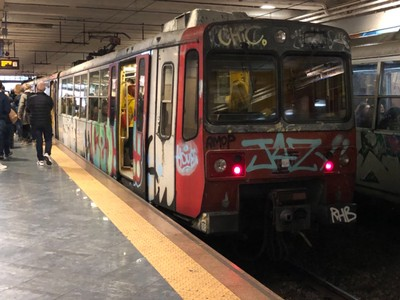 Graffiti-covered Circumvesuviana train in Naples
