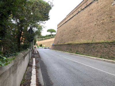 Most of the border of the Vatican City is a very high, sloping brick wall