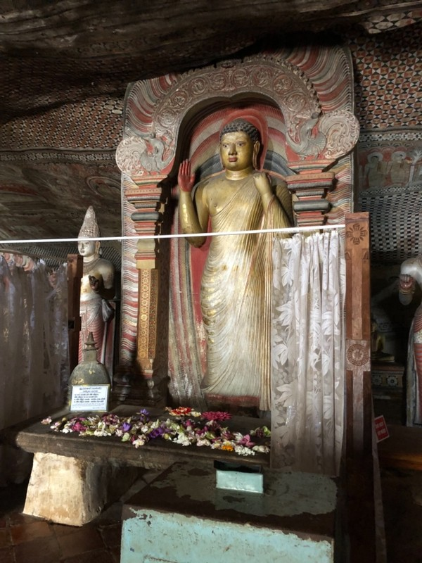 Standing Buddha at Dambulla Cave Temple