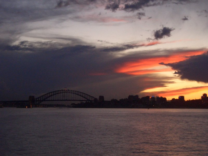 sydney skyline at dusk on ferry back from manly